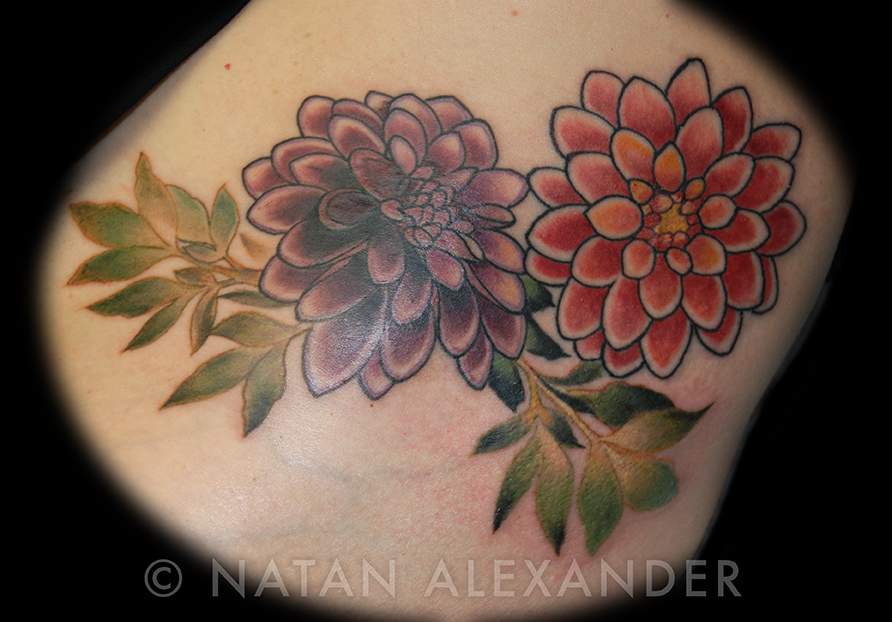 Color ink floral tattoo of dahlia flowers by Natan Alexander