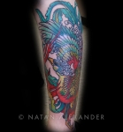 Tattoo of colorful phoenix bird with multicolored feathers in color ink by Natan Alexander.