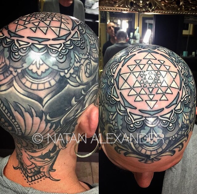 Full head tattoo of Sri Yantra triangle and circle crown chakra design in black gray ink by Natan Alexander