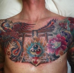Chest piece tattoo of a phoenix and flowers in color ink by Natan Alexander