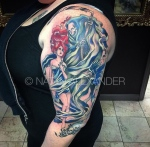 Arm tattoo of red haired lady clutching herself with the Grim Reaper looks upon her over skulls with a bird squawking nearby in color ink by Natan Alexander