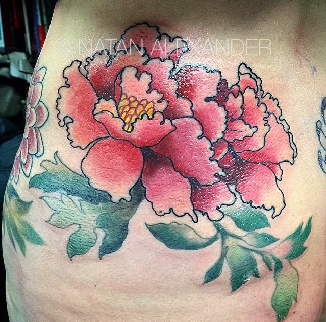 Hip tattoo of colorful pink peony flowers in the traditional Japanese style in color ink by Natan Alexander